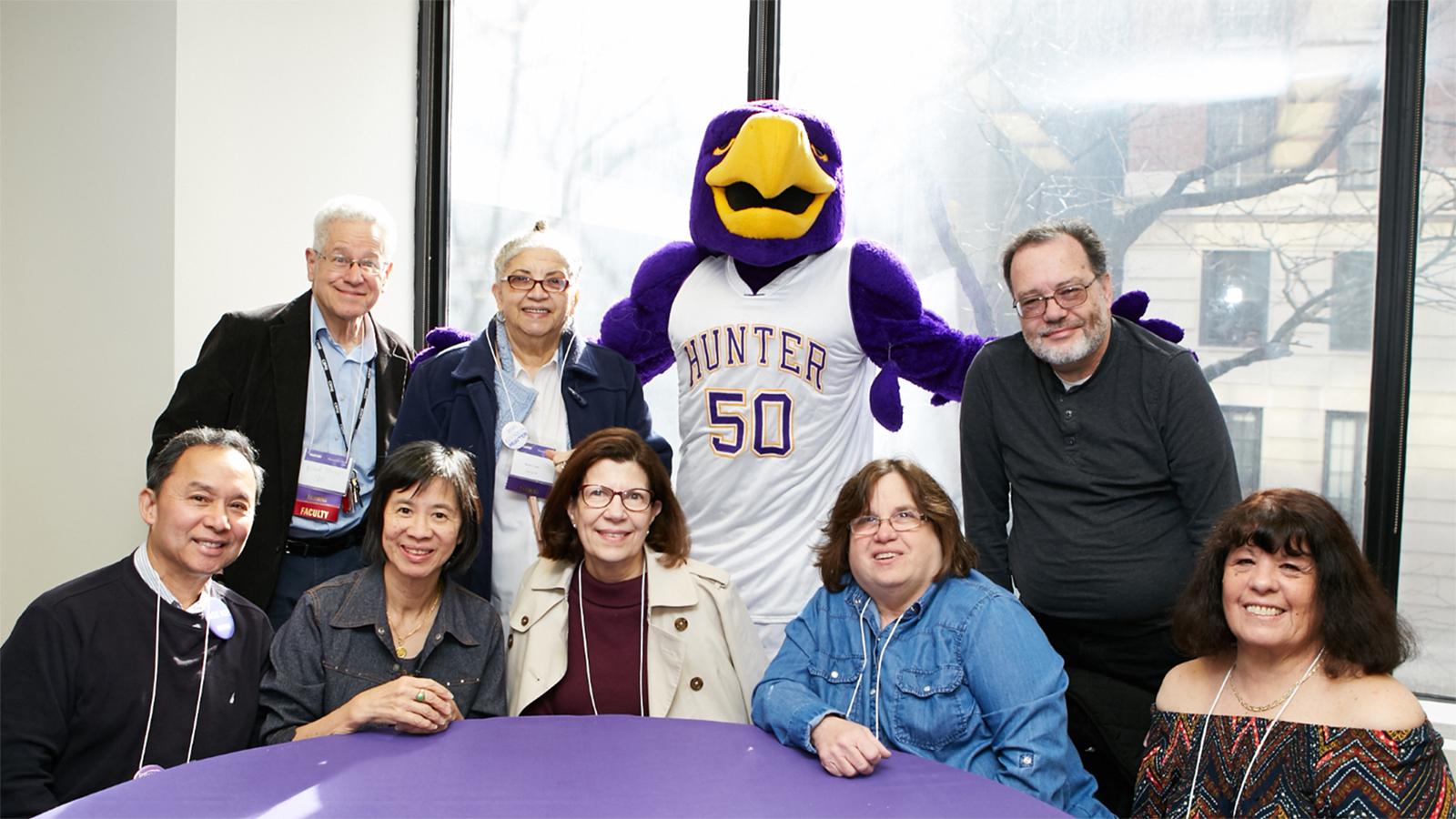 Photo - Senior Citizen Auditors pose with the Hunter Hawk