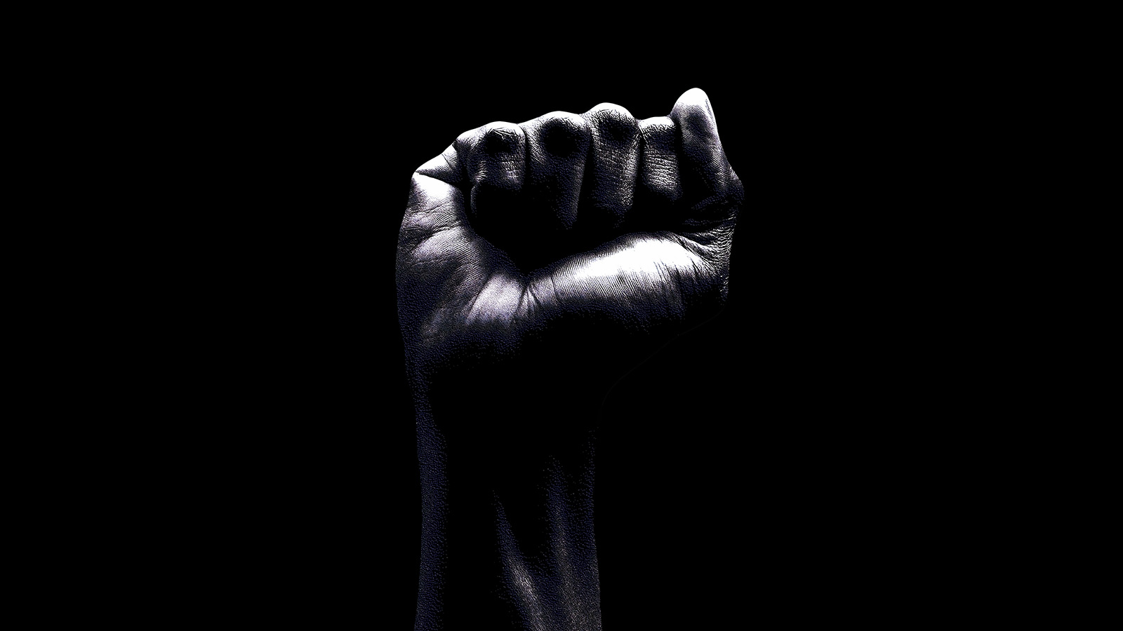 black fist on dark background