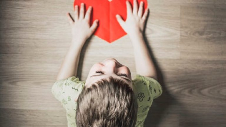 boy holding paper heart