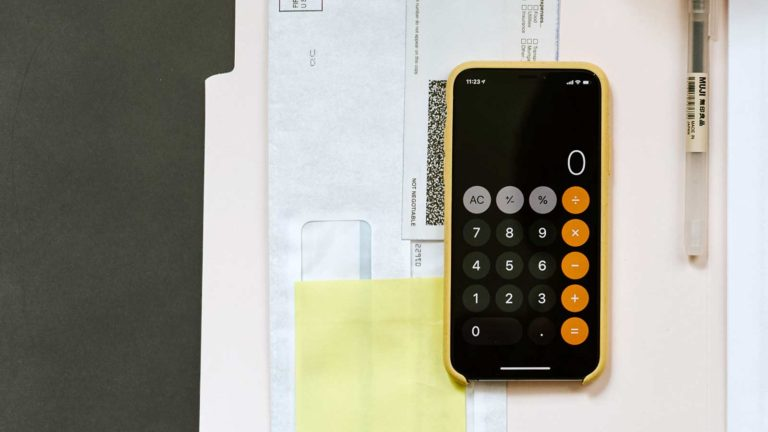 smart phone calculator on paperwork