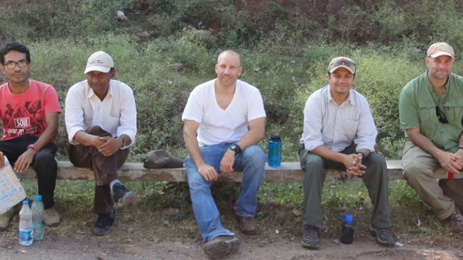 Professor Christopher Gilbert (center), at Ramnagar, is shown with members of the team, including (from left) N. P. Singh, R. Patnaik, B. Patel, and C. Campisano.