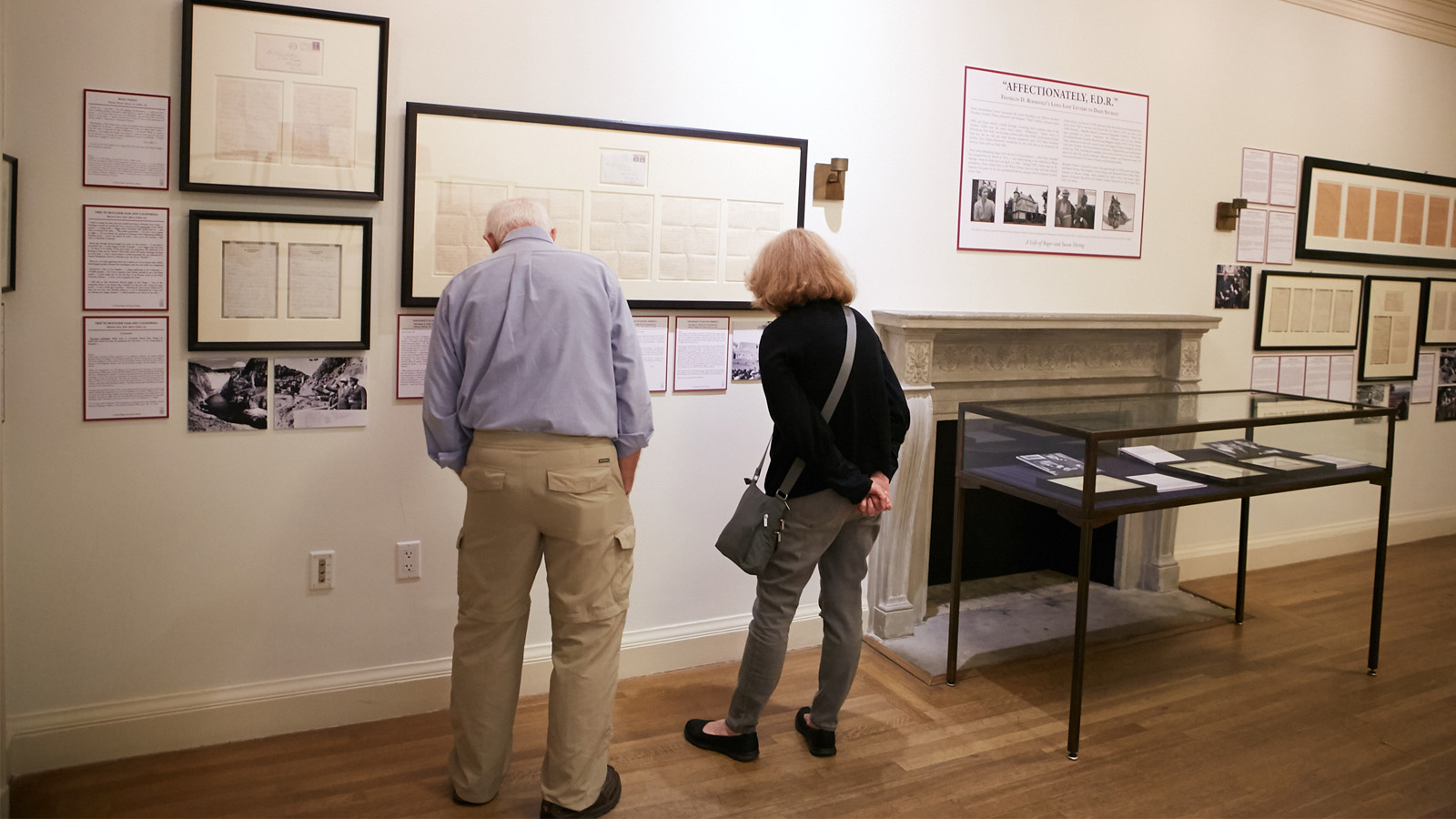 Two people looking at the FDR letters