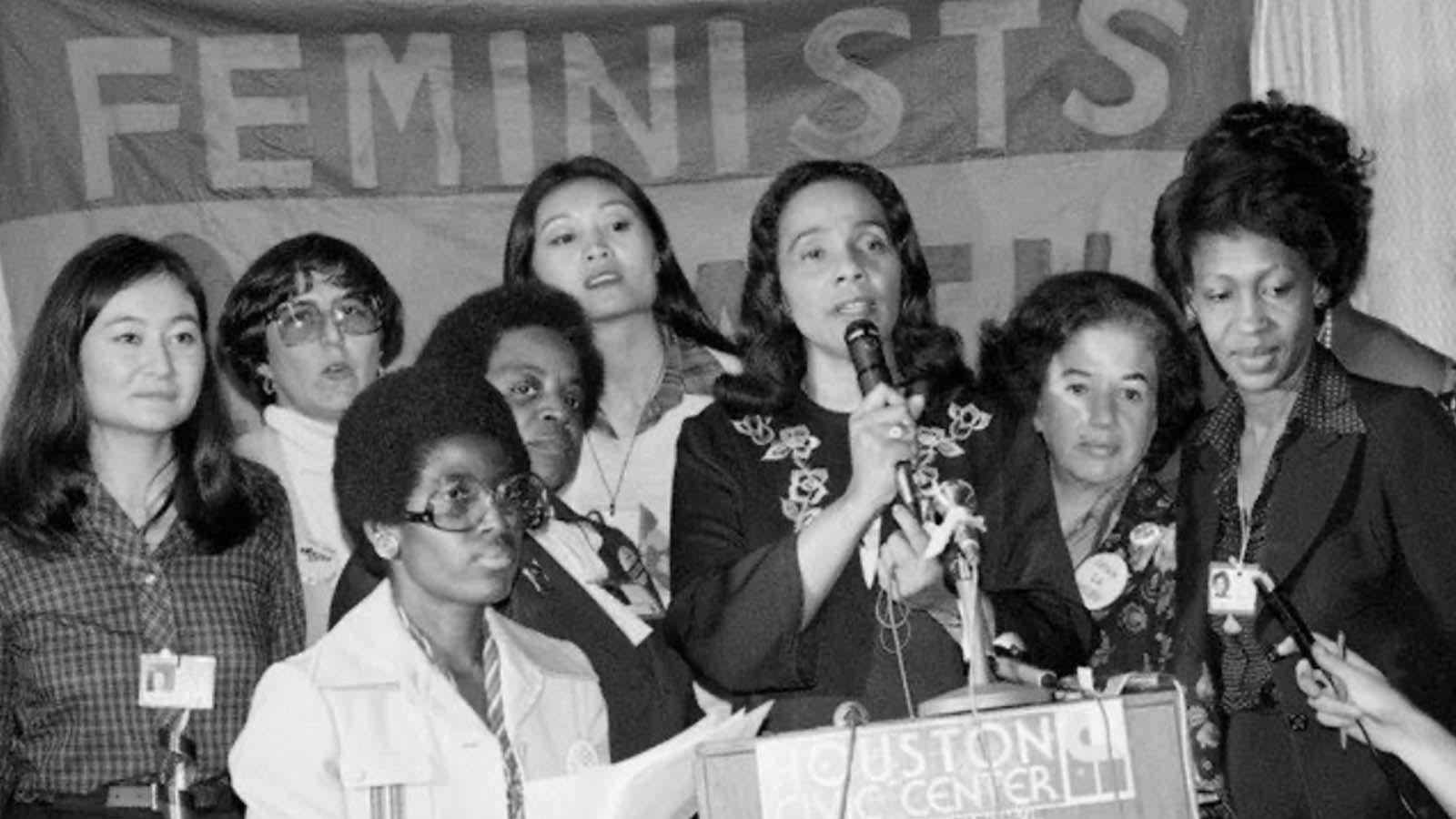 Feminists speaking at podium
