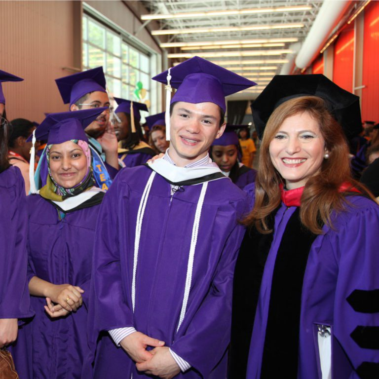 President Raab with students at graduation