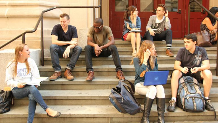 a group of students sitting on steps