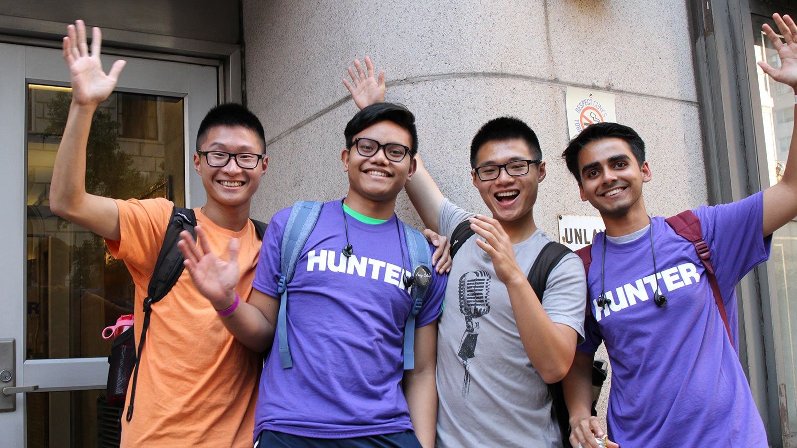 three hunter students waving