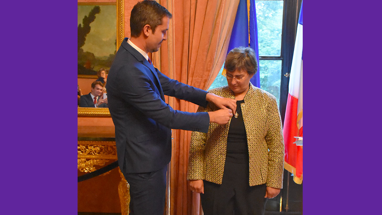 Jessica Neuwirth receiving the insignia of the Knight of the National Order of the Legion of Honor from Jérémie Robert, the Consul General of France in New York.