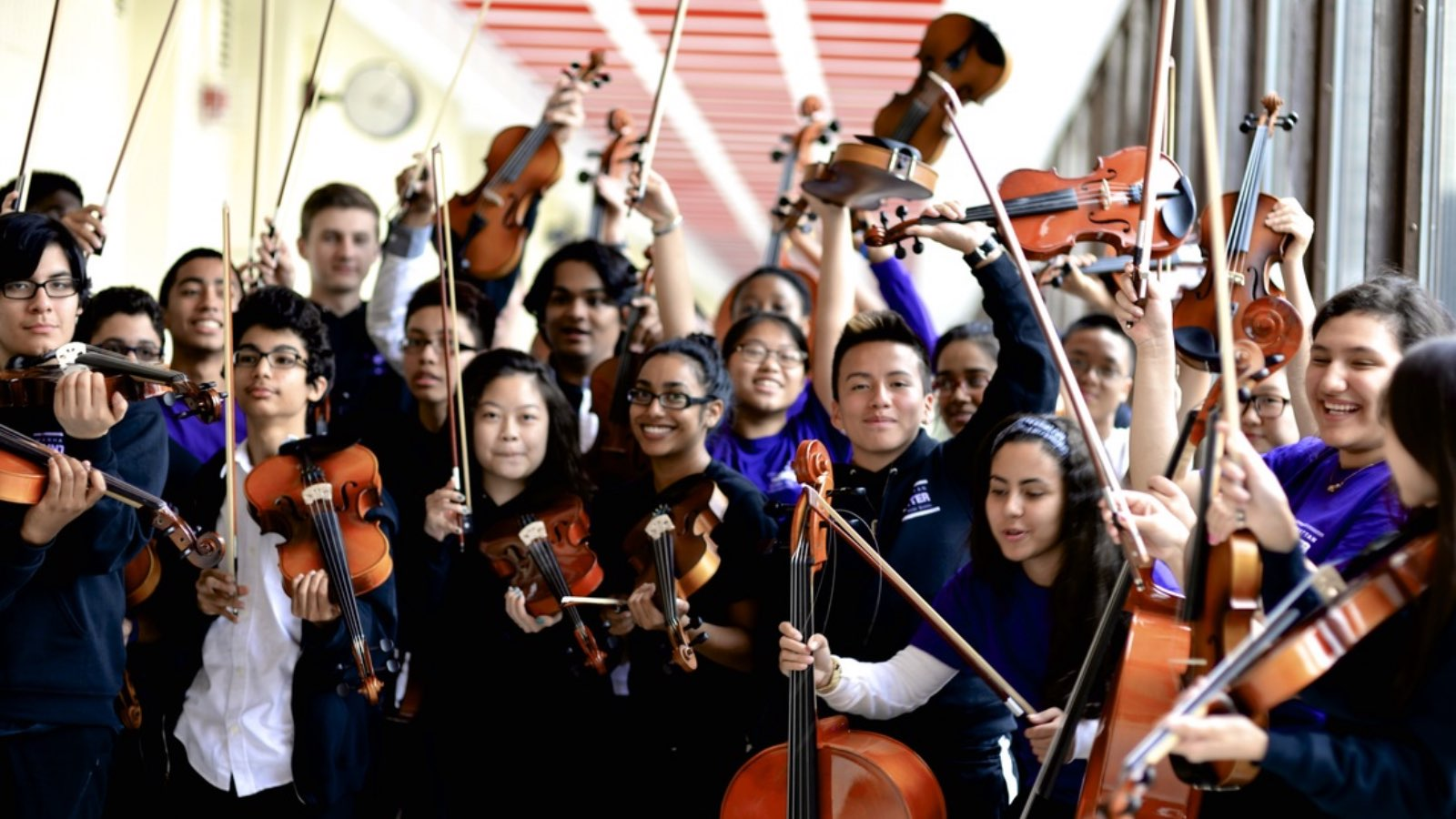 Group of students from Manhattan Hunter Science High School holding musical instruments.