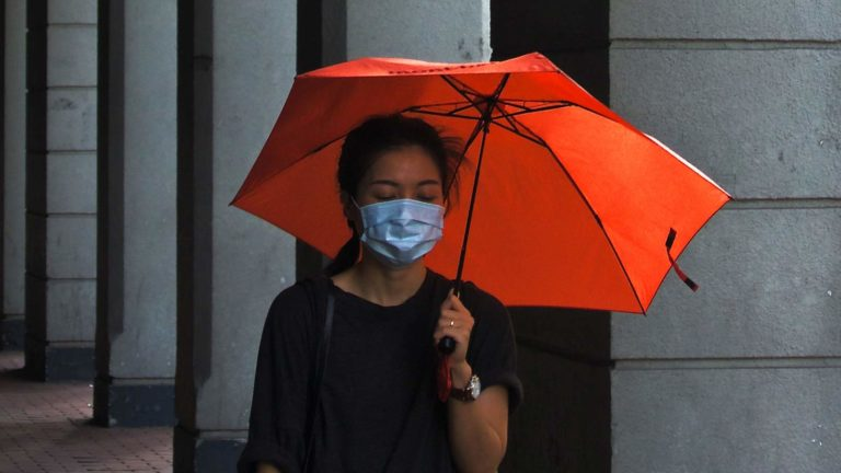 masked-woman-with-umbrella