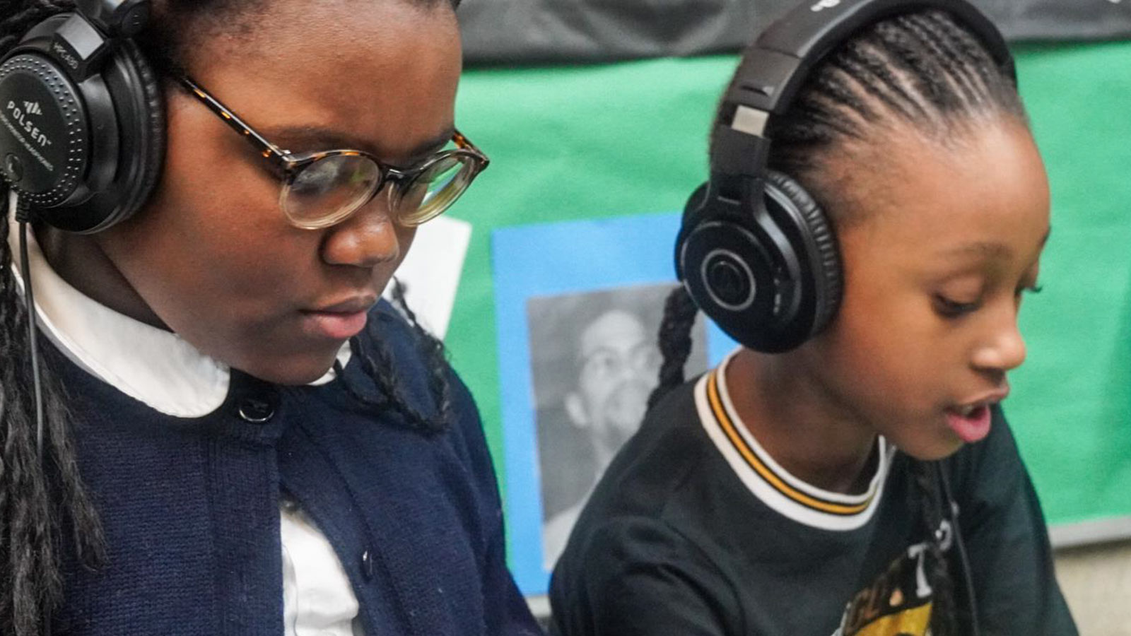 Students listening with headphones