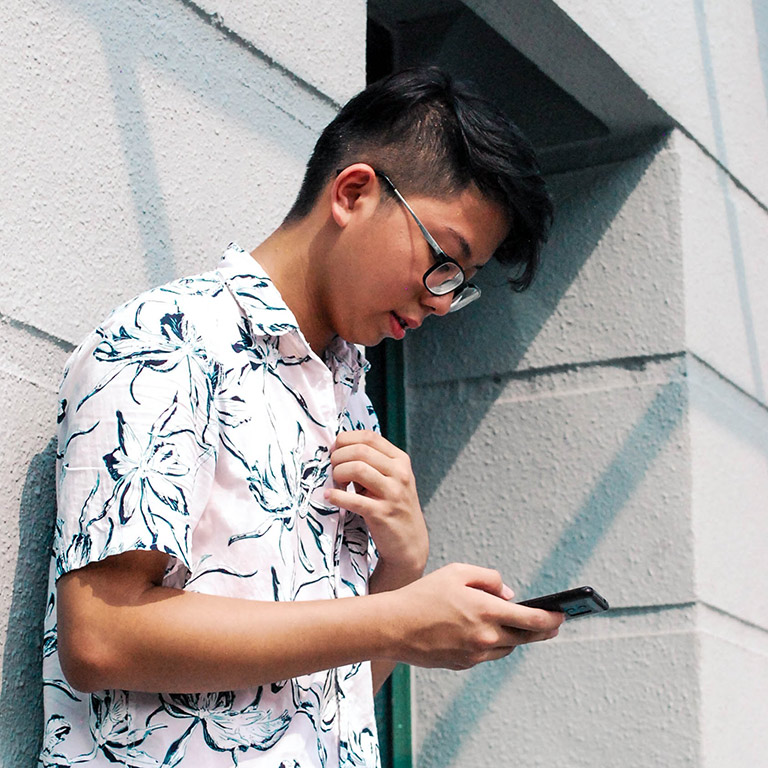 student looking at phone