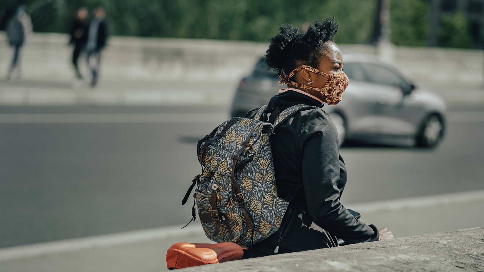 Student wearing mask on bike