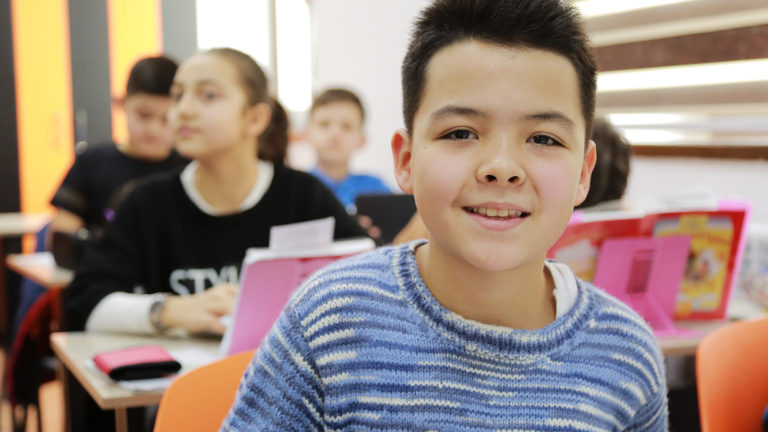 young boy in class