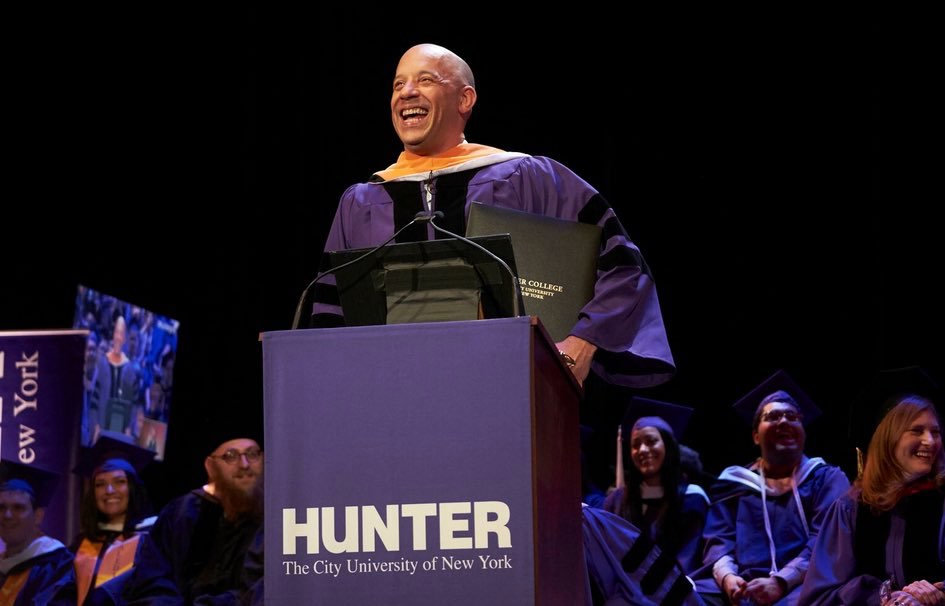Vin Diesel at podium during commencement