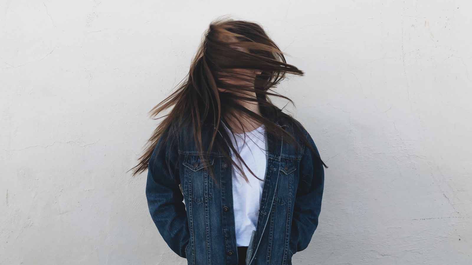 woman shaking her hair